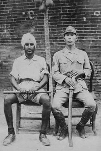 A Japanese officer of the Special Naval Landing Force (SNLF) with an Indian…