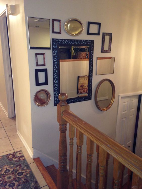 Split level entry mirror and frame collage