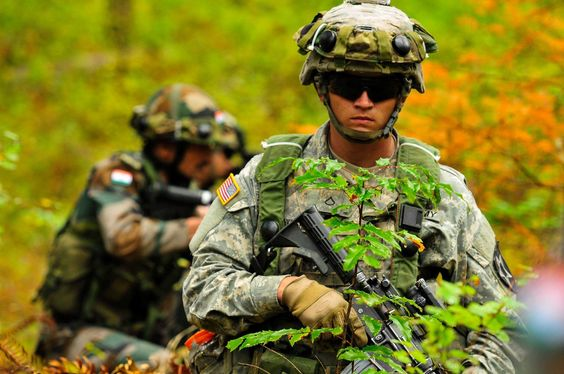 A #USArmy Soldier, assigned to 1-2 Stryker Brigade Combat Team, 7th Infantry Division and Indian army soldiers train to assault an objective during the U.S. Army Pacific-led Exercise #YudhAbhyas 15 at Joint Base Lewis-McChord, Wash., Sept. 17, 2015.