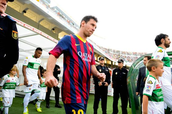 Lionel Messi of FC Barcelona walks onto the pitch prior to the La Liga match between Elche FC and FC Barcelona at Estadio Manuel Martinez Valero on May 11, 2014 in Elche, Spain.