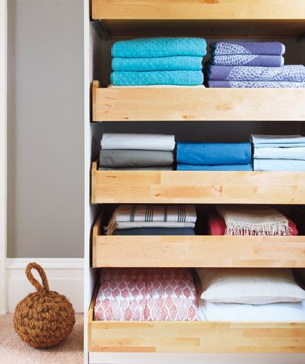 Install rolling shelves in deep storage spaces to make every corner of the closet or cabinet accessible.