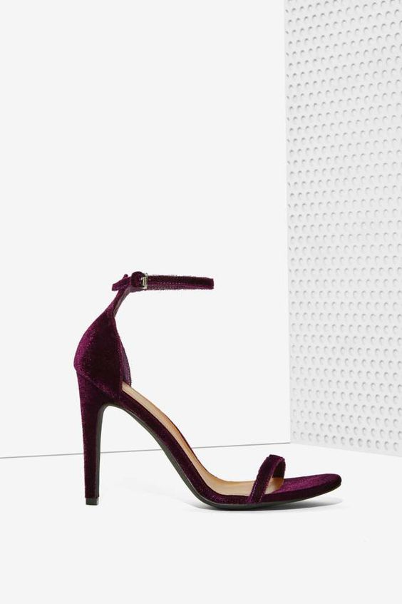 the ivy heel is made in a dark purple velvet dream with skinny strap at toes adjustable ankle strap and stiletto heel