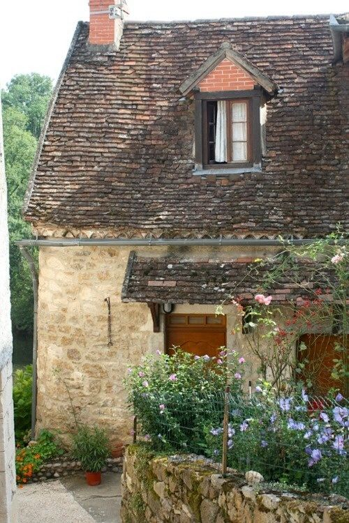 French Country Cottage exterior with stone. #europeanfarmhouse #frenchcountry #cottage #exterior