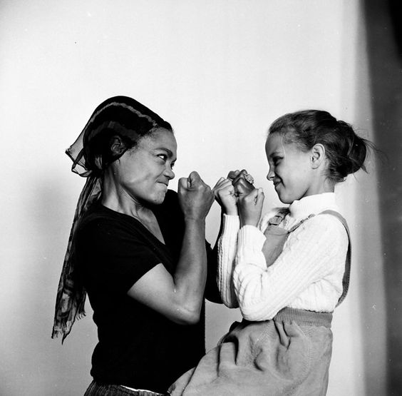 Eartha and daughter Kitt playing