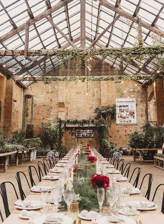 This beautiful botanical wedding was held inside an overflowing-with-foilage greenhouse in Barcelona.Could you picture anything more magical?: