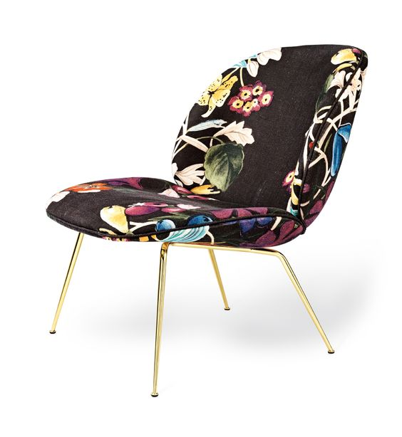 The GUBI Beetle lounge chair is a fashion-forward icon that captures the essence of Danish design. Designed by the ever-surprising GamFratesi. For more details, go to thehighstyle.com. #LuxeHoliday