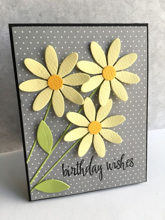 handmade birthday card fro I'm in Haven ... die cut daisies in yellow on gray polka dot background ... luv the crisp and cheery look ....