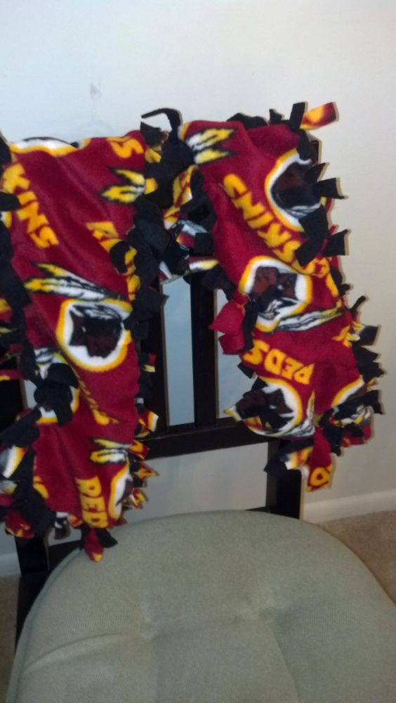 Redskins fleece scarf. Idk why the black on the other side but....yeah I would do yellow :)