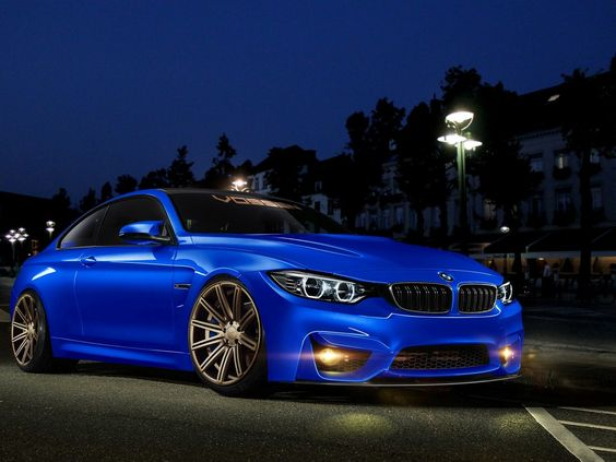BMW: A blue BMW awaits it's road run.  An incredible driving machine; quick, agile, and very responsive!