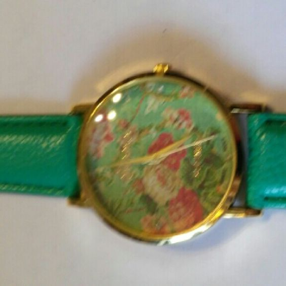 Green floral print Geneva leather look watch This is a brand new watch that I never used.It is brand new with a adjustable buckle from 6.50-8.25 inches.The stem is pulled so the battery is fresh. geneva Accessories Watches