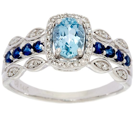 Blue on blue. This brilliant 14K gold ring features a prong-set, oval Santa… $739.00