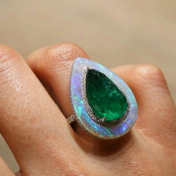 Emerald and opal ring by Koliero