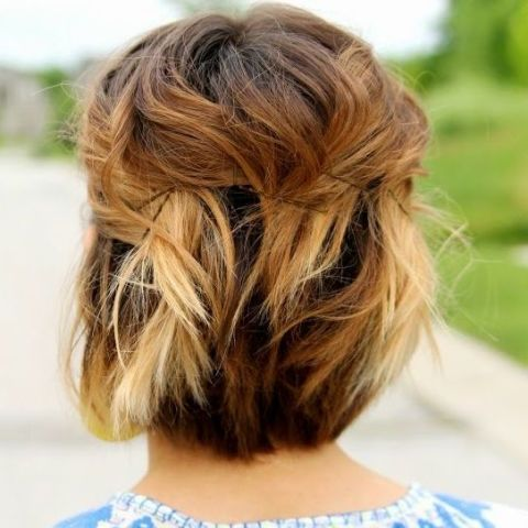 This sweet and simple 'do looks more polished than simply pulling your hair back into a half ponytail or clip.