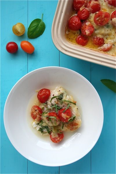 fish gratin with cheese, tomatoes and herbs
