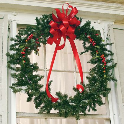 Hula-Hoop Wreath - Make an extra large #wreath using a hula-hoop! Hang it outside to welcome guests. #tutorial