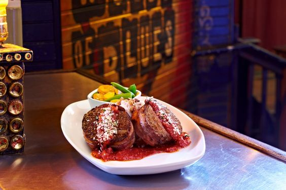 Bacon makes everything better, including our Applewood Bacon Wrapped Meatloaf! A delicious blend of savory flavors wrapped in applewood bacon, topped w/ house-made wild mushroom sauce alongside fresh veggies & red rose garlic mashed potatoes. #food #dining #foodie #restaurant #menu