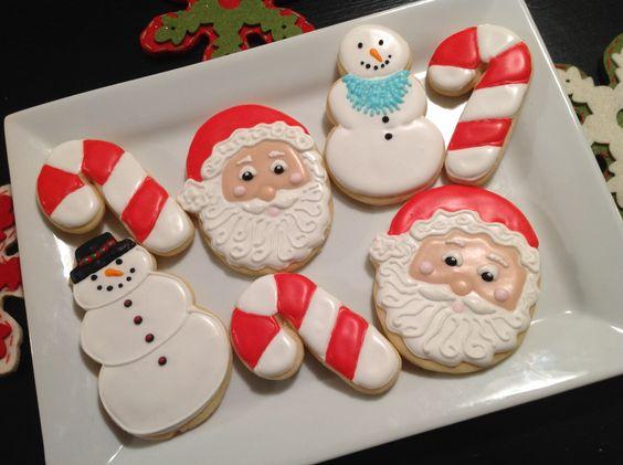 Santa, snowmen, and candy cane cookies by Kiwi's Kookies