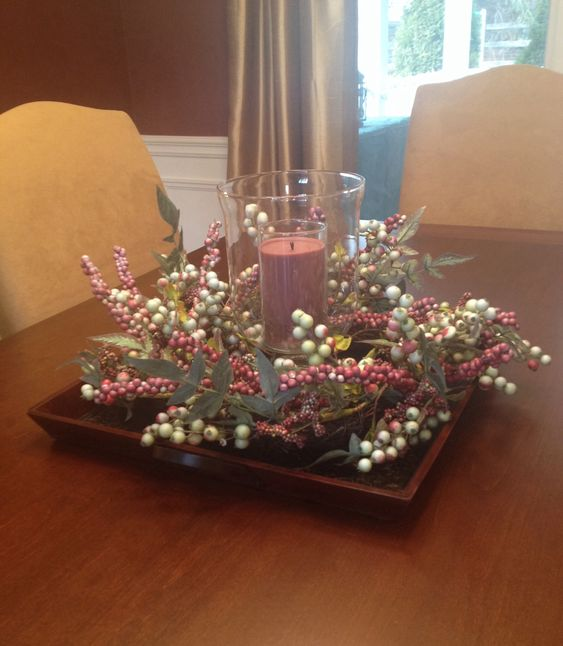 Dining room with flowers and candle on square plate for Glass centerpieces for dining room tables