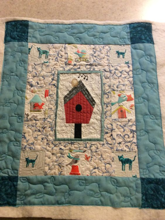 Cheryl's round robin for Saturday Stitchers. I did the quilting.