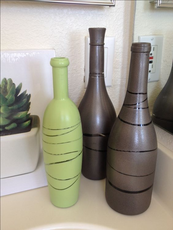wine bottles, rubber bands, and spray paint