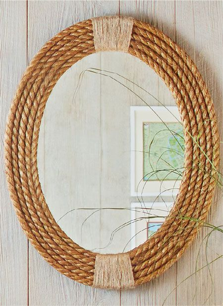 Customize an oval mirror by framing it with coils of rope for a nautical look.