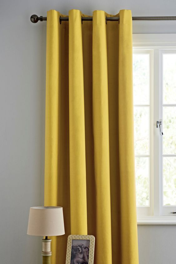 Buy Ochre Plain Blackout Eyelet Curtains from the Next UK online ...