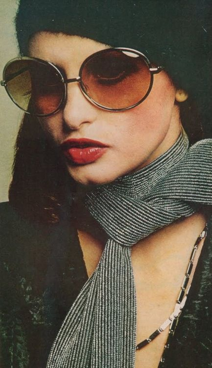 Appolonia wearing sunglasses for Vogue, Auguest 1972. Photo by Bob Stone