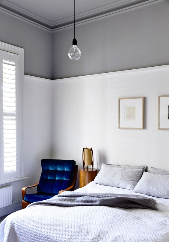 In the main bedroom, walls are in Dulux Natural White below the dado rail and Dulux Silkwort above. The 1970s Fred Lowen Tessa chair, picked up at a garage sale, has been upholstered in a Warwick Fabrics blue velvet.