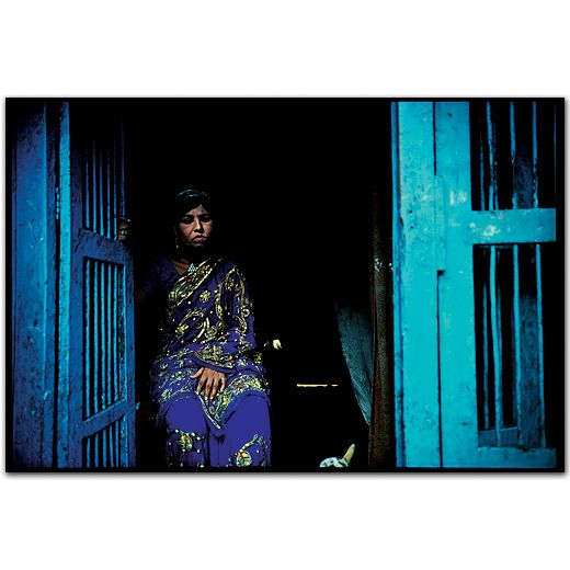 Champa, a transvestite madam, in the doorway of his cage.Falkland Road, Bombay, India.1978  by Mary Ellen Mark