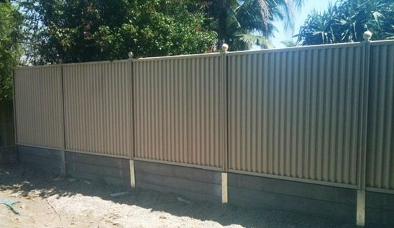Pioneer Smooth Grey Concrete Sleeper Retaining Wall The Colourbond Fence Is Attached Concrete Sleepers Sleeper Retaining Wall Concrete Sleeper Retaining Walls