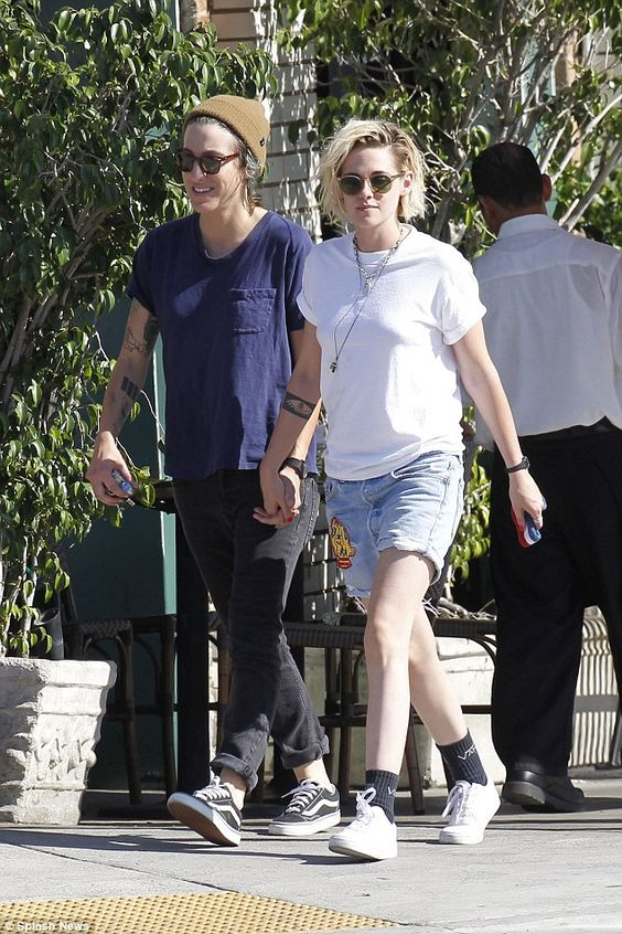 That's more like it: The American Ultra star seemed much more at ease holding hands with her paramour