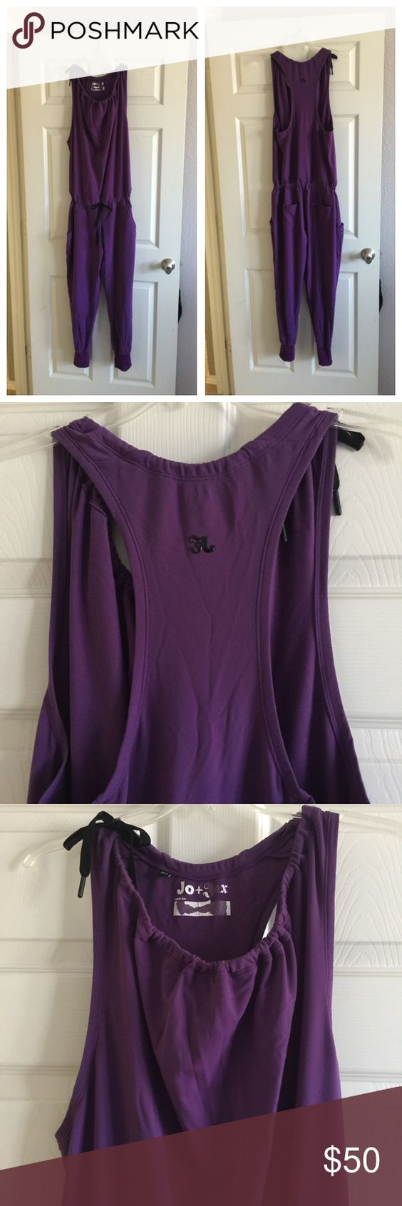 JO+JAX ROMPER EUC. Size: Medium. Jo+Jack Romper. Color: Purple. Drawstring at neckline. Drawstring waist. Front and Back Pockets. The only flaw is the vinyl lettering that is coming off the inside tag of the neckline. Jo+Jax Pants Jumpsuits & Rompers