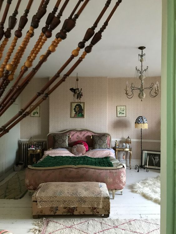 The beatutiful bedroom of Pearl Lowe featuring Anna Hayman Designs cushions and lampshades. A soft feminine design with antique furniture and and a touch of vintage glamour #vintageinterior #interiors #interiordesign #annahaymandesigns