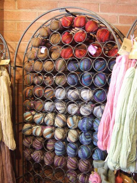 A great use for an old wine rack.  My yarn stash is in bins and I have to dig to find the color for which I'm looking.