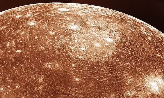 """Valhalla Crater on Callisto.  Callisto is the most heavily cratered satellite in the Solar System. Its surface has apparently been primarily sculpted by impacts. Valhalla is its largest crater - it's 360 km (225 miles) across and the rings extend to 1900 km (1190 miles) from its center. (Photo: NASA) ©Mona Evans,""""Jupiter's Galilean Moons"""" http://www.bellaonline.com/articles/art42279.asp"""