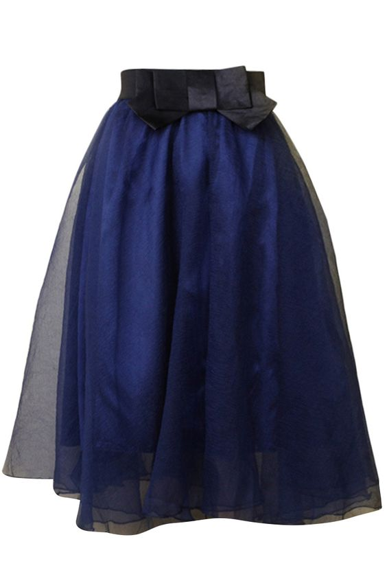 A midi skirt featuring tulle fabric with lining, a contrast ow waist, and an A-line silhouette.