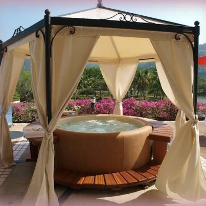Inflatable Hot Tub Surrounded By Gazebo and Curtains