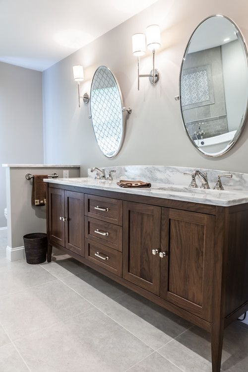 Furniture Vanity In A Walnut Finish Custom Double Sink Vanity Is Centered Between Two W Double Vanity Bathroom Double Sink Bathroom Vanity Bathrooms Remodel