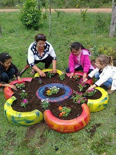 Collect a number of recycled tires and paint them. After painting all tires, place them into the shape of a flower, add dirt and plants. ( recycle tires ) ( always see old tires in the woods )