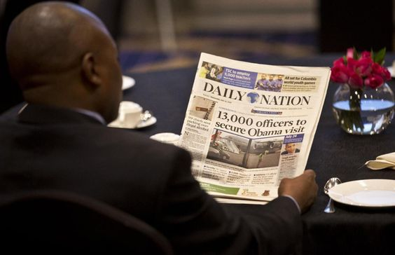 A man attending an investors breakfast meeting with the Mama Sarah Obama Foundation charitable organization, named after President Barack Obama's step-grandmother reads a copy of the Kenyan Daily Nation newspaper whose front page highlights the security measures being put in place ahead of the Presidents visit to the country later in the month, in Nairobi, Kenya Wednesday, July 15, 2015. Pres Barack Obama is due to make his first trip as president to Kenya, the country of his fathers birth