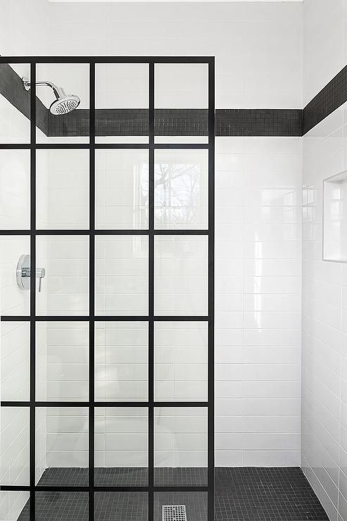 A Black Steel And Glass Partition Is Fitted To A Doorless Walk In