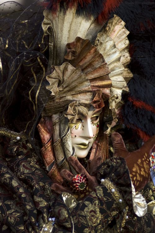 A beautiful costume and a contemplative, almost sad mask.