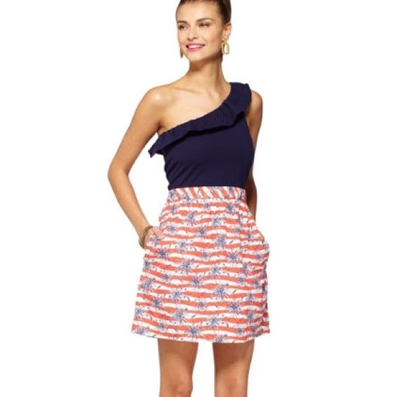 Lilly Pulitzer Dionne Dress Memorial Day and Independence Day are just around the corner-- this is arguably THE best dress Lilly has ever created for the occasion. The firecrackers print is too perfect. The one shoulder ruffle and knit/woven combo is comfortable yet chic, the dress has pockets, and IT GLOWS IN THE DARK! Lilly Pulitzer Dresses One Shoulder