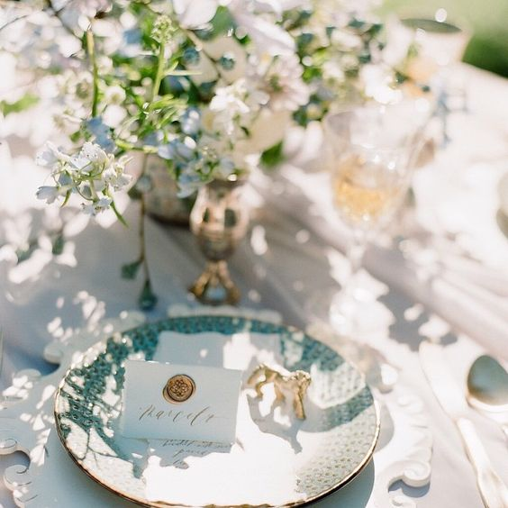 """Ornate, light colours, curves, playful yet graceful and witty...inspired by the artistic style of Rococo.  Each place setting was graced with a custom wax…"""
