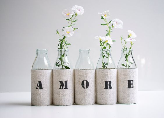 AMORE vase -  from 5 small recycled glass bottles and a grain sack cover. $29.00, via Etsy.