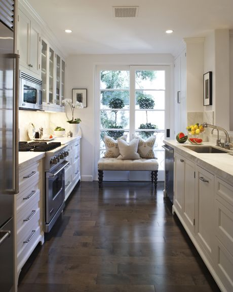 White kitchen cabinets in gallery kitchen white marble countertops