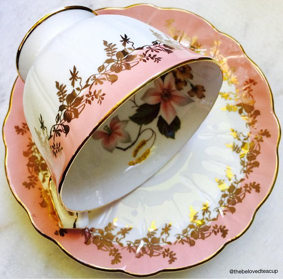 Gorgeous dusty rose Aynsley crocus shaped tea cup and saucer featuring elegant gold filigree details and inner floral designs. Measurements: Cup is 2 3/4 tall x 3 1/2 wide and Saucer is 5 in diameter ~~~~~~~~~~~~~~~~~~~~~~~~~~~~~~~~~~~~~~~~~~~~ ~Complimentary antique sugar spoon