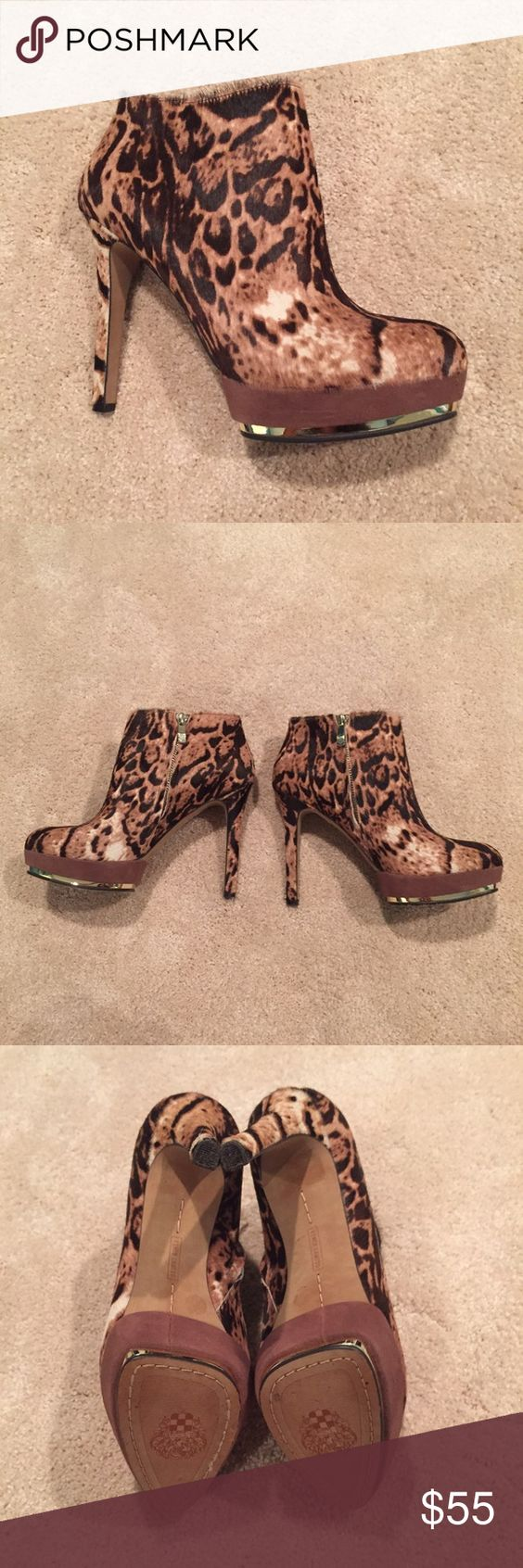 Vince Camuto leopard print booties Fierce booties in great condition, hardly worn. There's some dark marking on the inside of the booties near the zipper, but it doesn't show at all on the outside. Beautiful gold trim on the bottom platform and gold zipper on the inside! Vince Camuto Shoes Ankle Boots & Booties