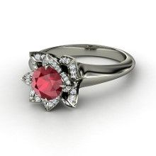 This ring would look better if it had been set with all rubies. Then it would really look like a rose.