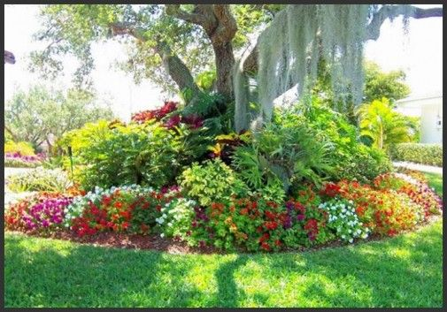 Flowers Garden design inspiration 4 ... I like the collection of flowers around a tree base.